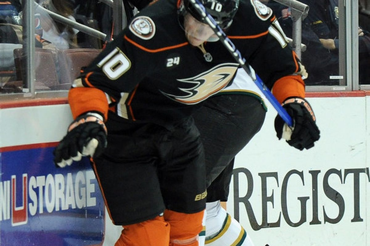 The cop in the background is not happy at the thought that Corey Perry could have been on the Stars.