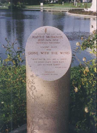A gravestone with words that read: Hattie McDaniel academy award Gone with the Wind.