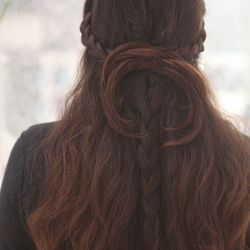 Step 4: Take the two braids from the sides and pull them towards the back of the head.  Criss-cross them over the center back braid.    Step 5: Using bobby pins, secure the side braids to the center braid where they meet leaving the ends of the braids l