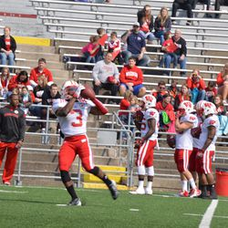 Wide receiver Kenzel Doe hauls in a pass during warmups.