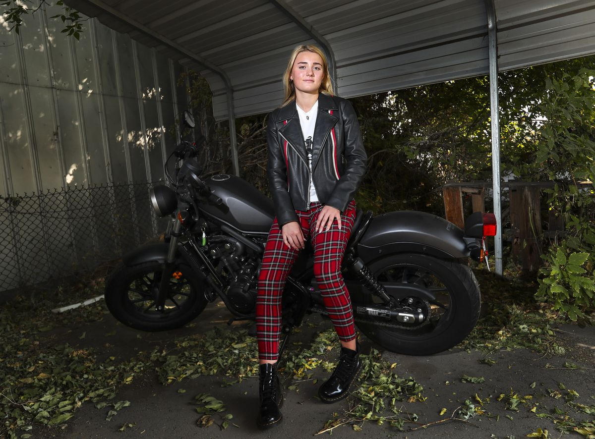 University of Utah freshman Stephanie Burnham poses for a photo with her motorcycle at her family's business in Salt Lake City on Tuesday, Oct. 6, 2020. Burnham lives on campus in the Lassonde Entrepreneur Institute Studio building and is a member of a new cohort there that is made up of students who founded companies in high school or earlier.