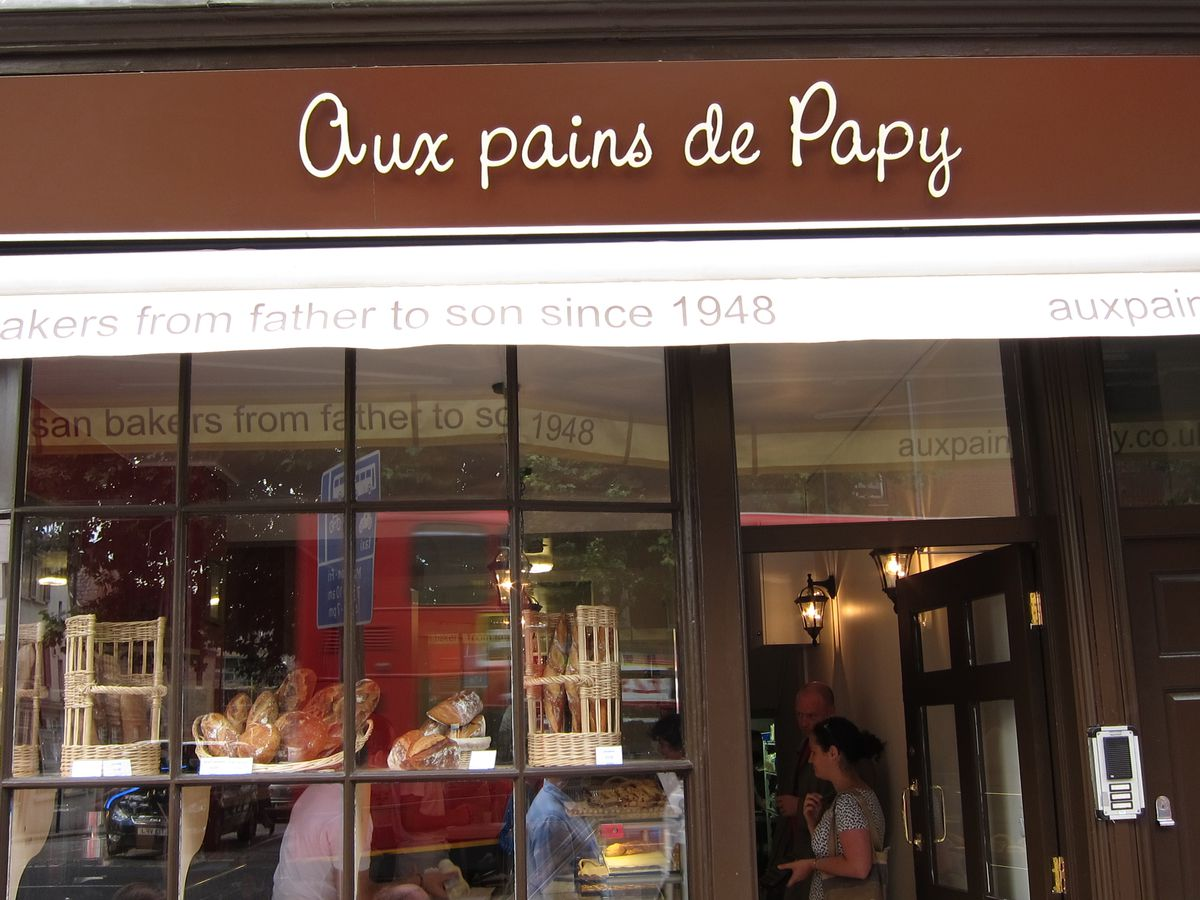 The brown frontage and awning of Aux Pains de Papy bakery in King's Cross