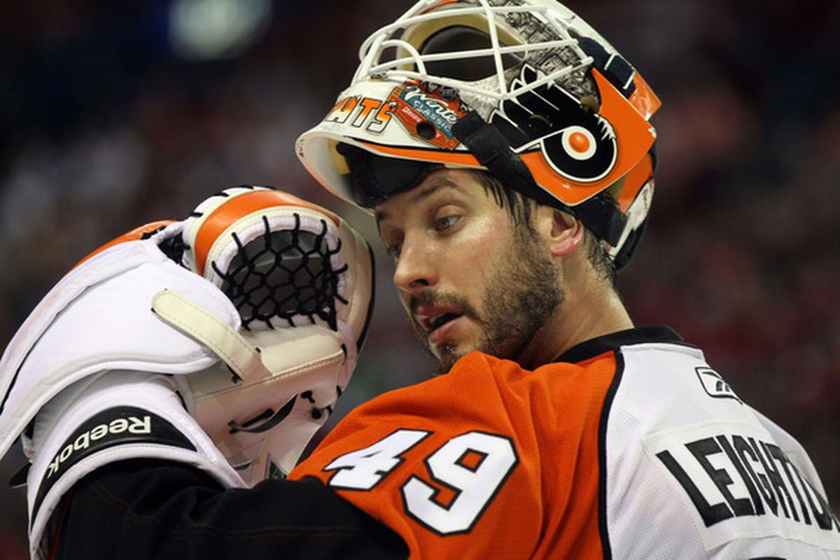 Mike Leighton pictured after mentally snapping after giving up 5 goals to the Canadiens. The glove doesn't talk back Michael.