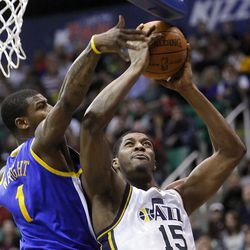 Utah Jazz forward Derrick Favors (15) has his shot blocked by Golden State's #1 Dorell Wright as the Utah Jazz and the Golden State Warriors play Friday, April 6, 2012 in Salt Lake City. Jazz won 104-98.