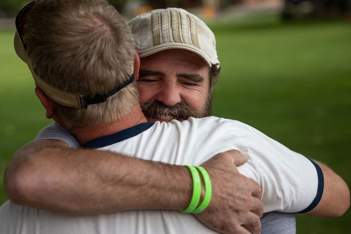 Sean-Paul Schulte hugs friend Scott Gorgacz in Swanny Park in Moab on Sunday, Sept. 19, 2021. Schulte has been in the park every day for the past two weeks seeking community tips in the murder of his daughter, Kylen Schulte, and her wife, Crystal Turner.