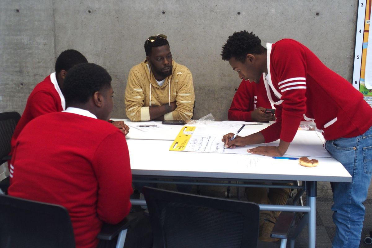Memphis alternative school students work with local activist Keedran Franklin, in yellow, to brainstorm policy proposals to prevent other youth from being incarcerated. At the top of the list was mentoring and jobs. Just under that was a call to eliminate suspensions and expulsions and replace with fostering better relationships between teachers and students.