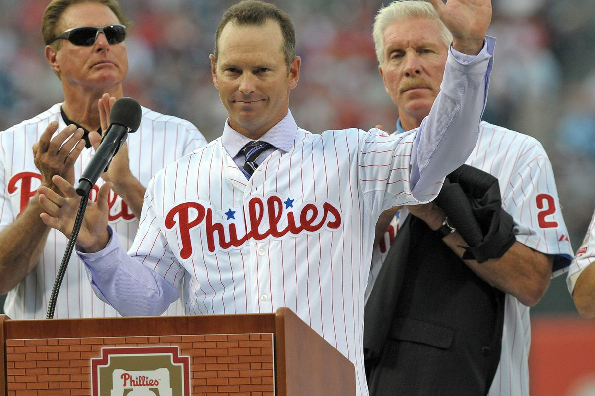 Seriously, how can you not love Mike Lieberthal? Michael Jack loves him enough to hold his suit jacket! I think that's what Steve Carlton is actually applauding for. Mandatory Credit: Eric Hartline-US PRESSWIRE