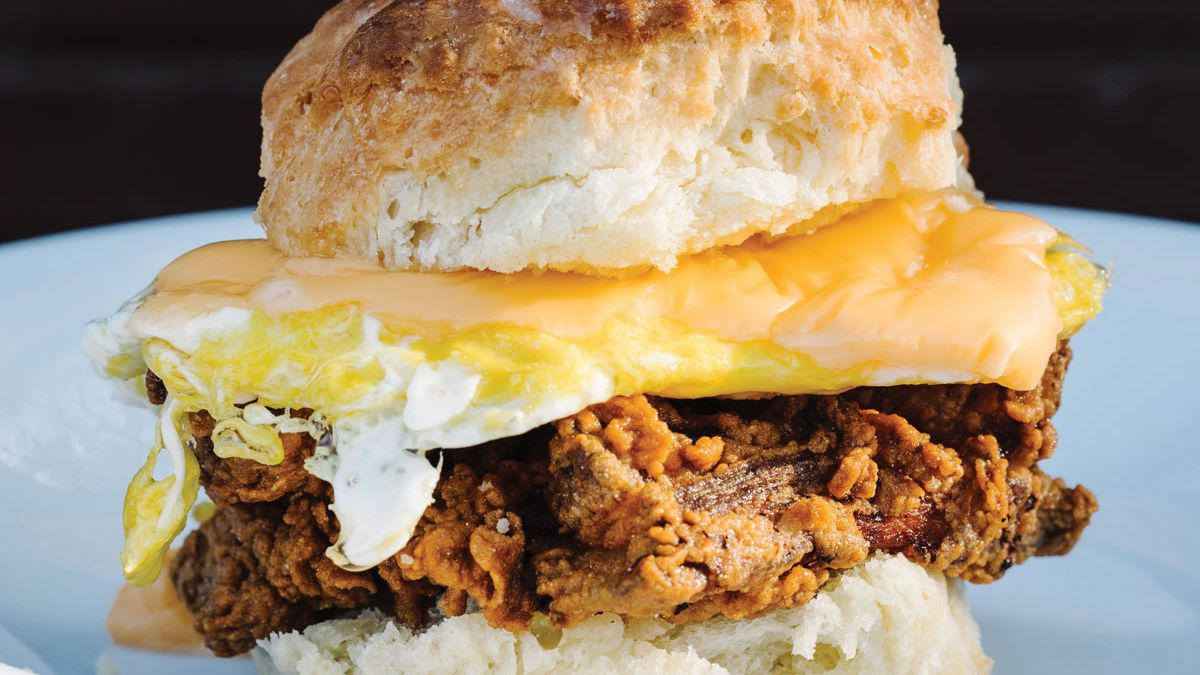 Fried chicken biscuit topped with egg and cheese from Bomb Biscuit in Atlanta