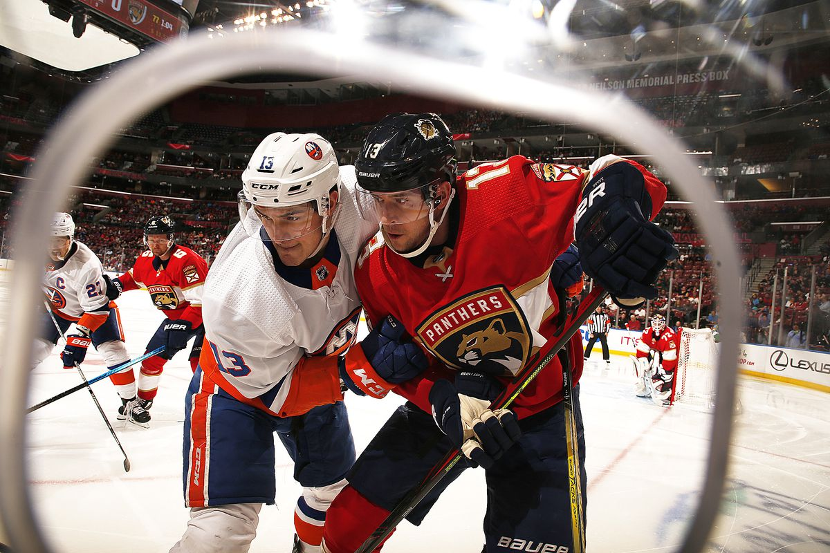Mathew Barzal of the New York Islanders tangles with Mark Pysyk of the Florida Panthers at the BB&T Center on December 12, 2019 in Sunrise, Florida.