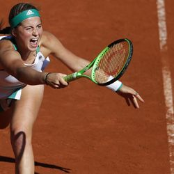 Latvia's Jelena Ostapenko plays a shot against Timea Bacsinszky of Switzerland during their semifinal match of the French Open tennis tournament at the Roland Garros stadium, in Paris, France. Thursday, June 8, 2017.
