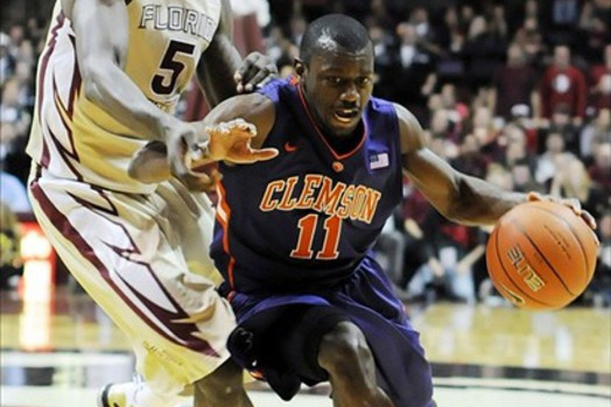 Mar 4, 2012; Tallahassee, FL, USA; Clemson Tigers guard Andre Young (11)  moves the ball past Florida State Seminoles forward Bernard James (5)during the first half at the Donald L. Tucker Center.  Mandatory Credit: Melina Vastola-US PRESSWIRE