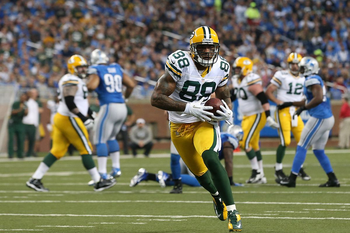 Jermichael Finley (88) scores on a 20 yard pass from Aaron Rogers (12) during the second quarter of the game against the Detroit Lions at Ford Field on November 18, 2012