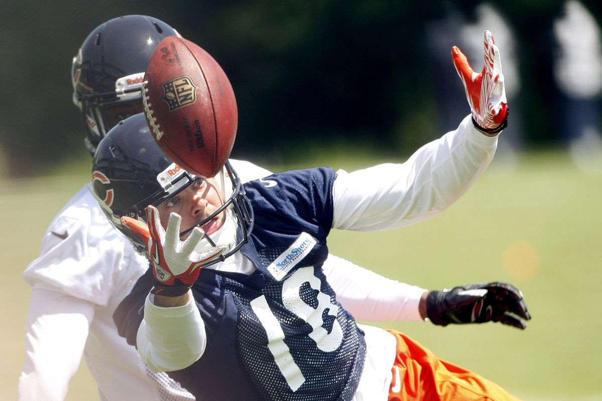 May 23, 2012; Lake Forest, IL, USA; Chicago Bears receiver Dane Sanzenbacher (18) juggles a pass while defended by defensive back Donovan Warren during organized team activities at Halas Hall.  Mandatory Credit: Jerry Lai-US PRESSWIRE