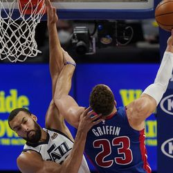 Detroit Pistons forward Blake Griffin (23) makes a layup as Utah Jazz center Rudy Gobert defends during the first half of an NBA basketball game, Sunday, Jan. 10, 2021, in Detroit.
