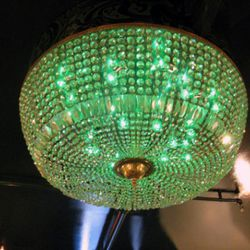They're keeping the chandelier, but the green bulbs might go.