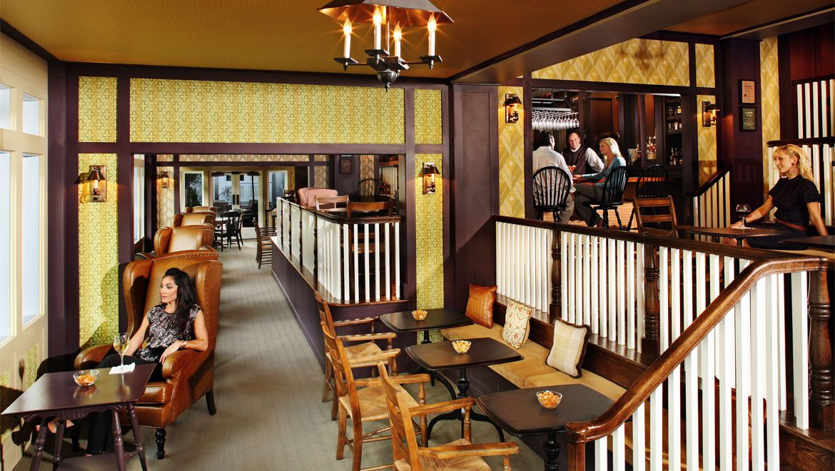 A rendering of a wood-paneled dining room with a hanging candle chandelier