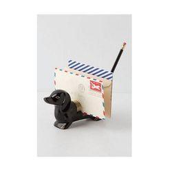 "<b>Anthropologie</b> <a href=""http://www.anthropologie.com/anthro/product/shopgifts-hostess/25489923.jsp"">Dachshund Letter Holder</a>, $32"