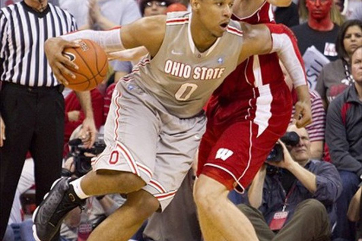 February 26, 2012; Columbus, OH, USA; Ohio State Buckeyes forward Jared Sullinger (0) spins past Wisconsin Badgers forward/center Jared Berggren (40) at Value City Arena. Wisconsin won the game 63-60. Mandatory Credit: Greg Bartram-US PRESSWIRE