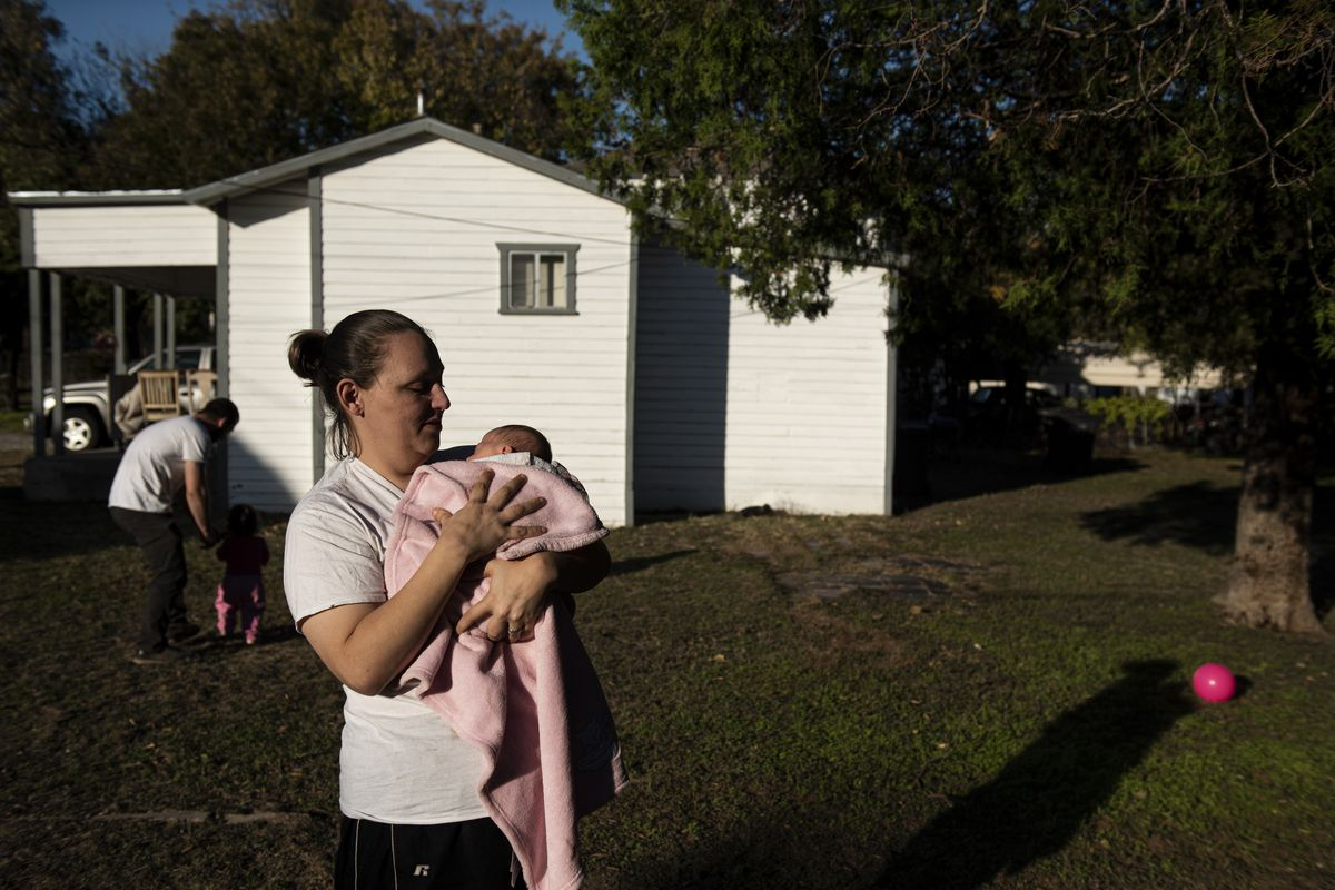 Revilla holds Cheyenne outside of her home.