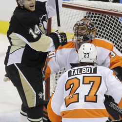 Pittsburgh Penguins' Chris Kunitz (14) celebrates his first-period goal against  Philadelphia Flyers goalie IIya Bryzgalov (30) during Game 2 of an opening-round NHL hockey playoff series in Pittsburgh, Friday, April 13, 2012.
