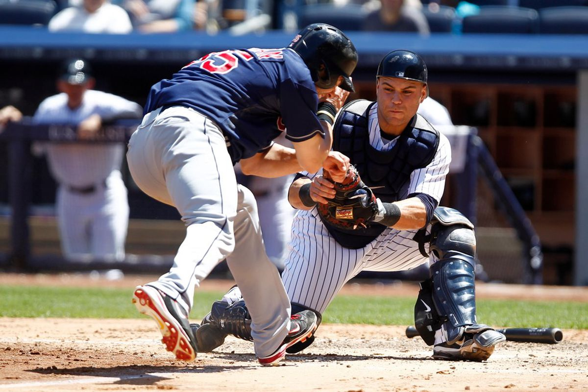 June 27, 2012; Bronx, NY, USA; New York Yankees catcher Russell Martin (55) tags out Cleveland Indians first baseman Casey Kotchman (35) during the fifth inning at Yankee Stadium. Debby Wong-US PRESSWIRE