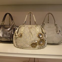 Madison Gathered Leather Large Sophia Satchel in a Light Grey (third on right $598)