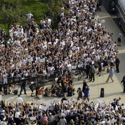 Penn State football fans surround the Penn State football team buses as Penn State head coach Bill O'Brien, center, leads his team into Beaver Stadium for their season opener against Ohio in State College, Pa., Saturday, Sept. 1, 2012.