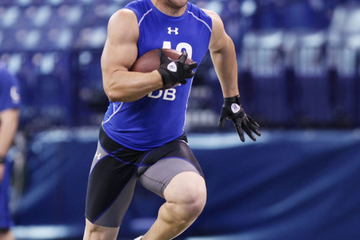 INDIANAPOLIS, IN - MARCH 1: Defensive back Tyler Sash #42 of Iowa runs with the football during the 2011 NFL Scouting Combine at Lucas Oil Stadium on February 28, 2011 in Indianapolis, Indiana. (Photo by Joe Robbins/Getty Images)