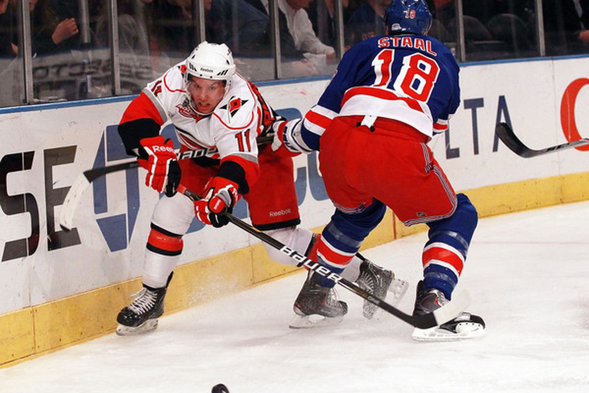 NEW YORK NY - JANUARY 05: Zach Boychuk #11 of the Carolina Hurricanes moves the puck around Marc Staal #18 of the New York Rangers at Madison Square Garden on January 5 2011 in New York City.  (Photo by Bruce Bennett/Getty Images)