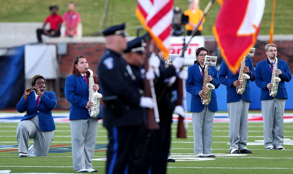 A member of the against the Southern Methodist Mustangs marching band kneels during the playing of the national anthem before the Southern Methodist Mustangs take on the TCU Horned Frogs at Gerald J. Ford Stadium on September 23, 2016 in Dallas, Texas.