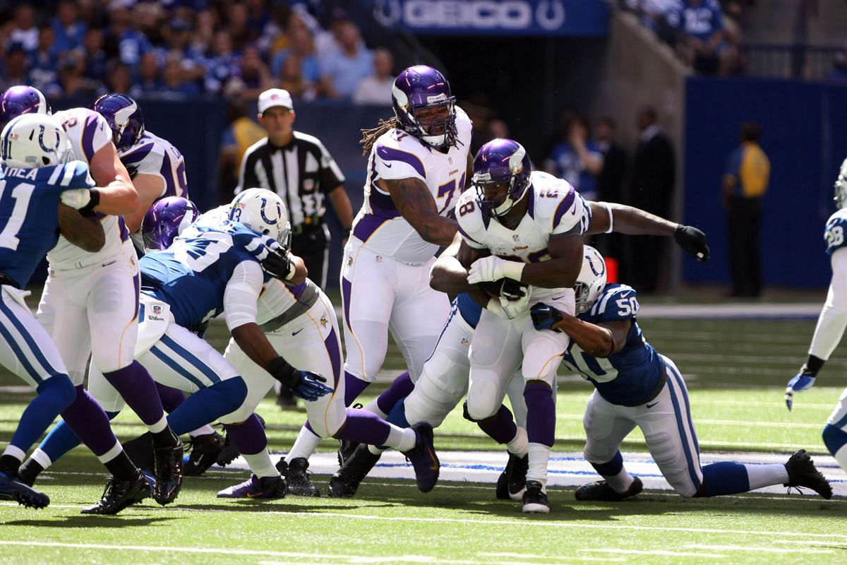 Sep 16, 2012; Indianapolis, IN, USA; Minnesota Vikings running back Adrian Peterson (28) runs with the ball against the Indianapolis Colts at Lucas Oil Stadium. Indianapolis defeats Minnesota 23-20. Mandatory Credit: Brian Spurlock-US PRESSWIRE