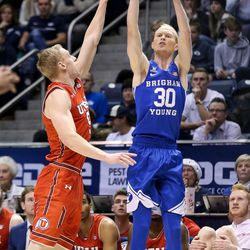 Brigham Young Cougars guard TJ Haws (30) shoots over Utah Utes guard Parker Van Dyke (5) at the Marriott Center in Provo on Saturday, Dec. 16, 2017.