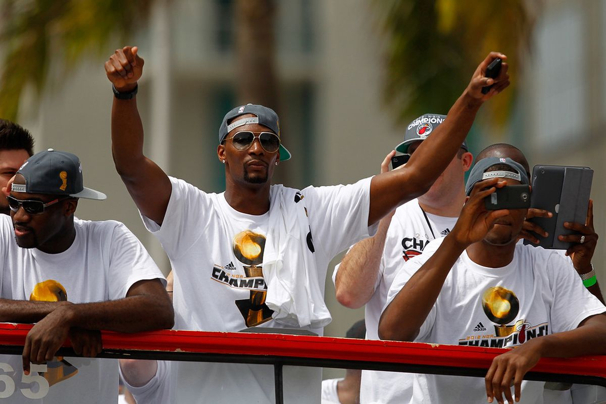 MIAMI, FL - JUNE 25:  Chris Bosh of the Miami Heat waves to the crowd during a celebration parade for the 2012 NBA Champion Miami Heat on June 25, 2012 in Miami, Florida.  (Photo by Sarah Glenn/Getty Images)
