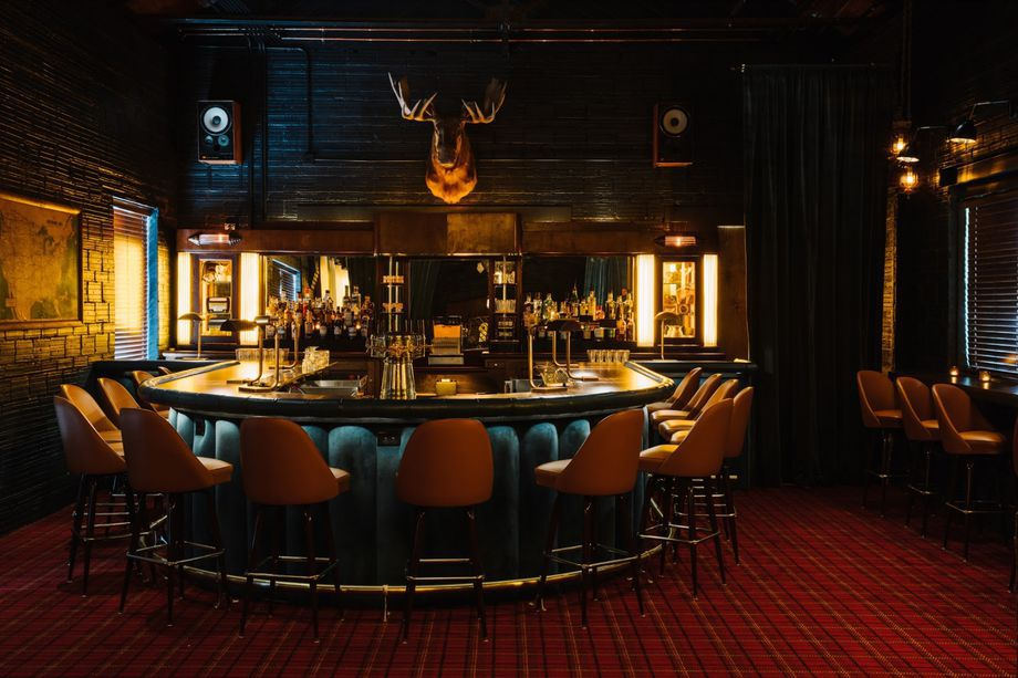 A bar with a moose head over it.