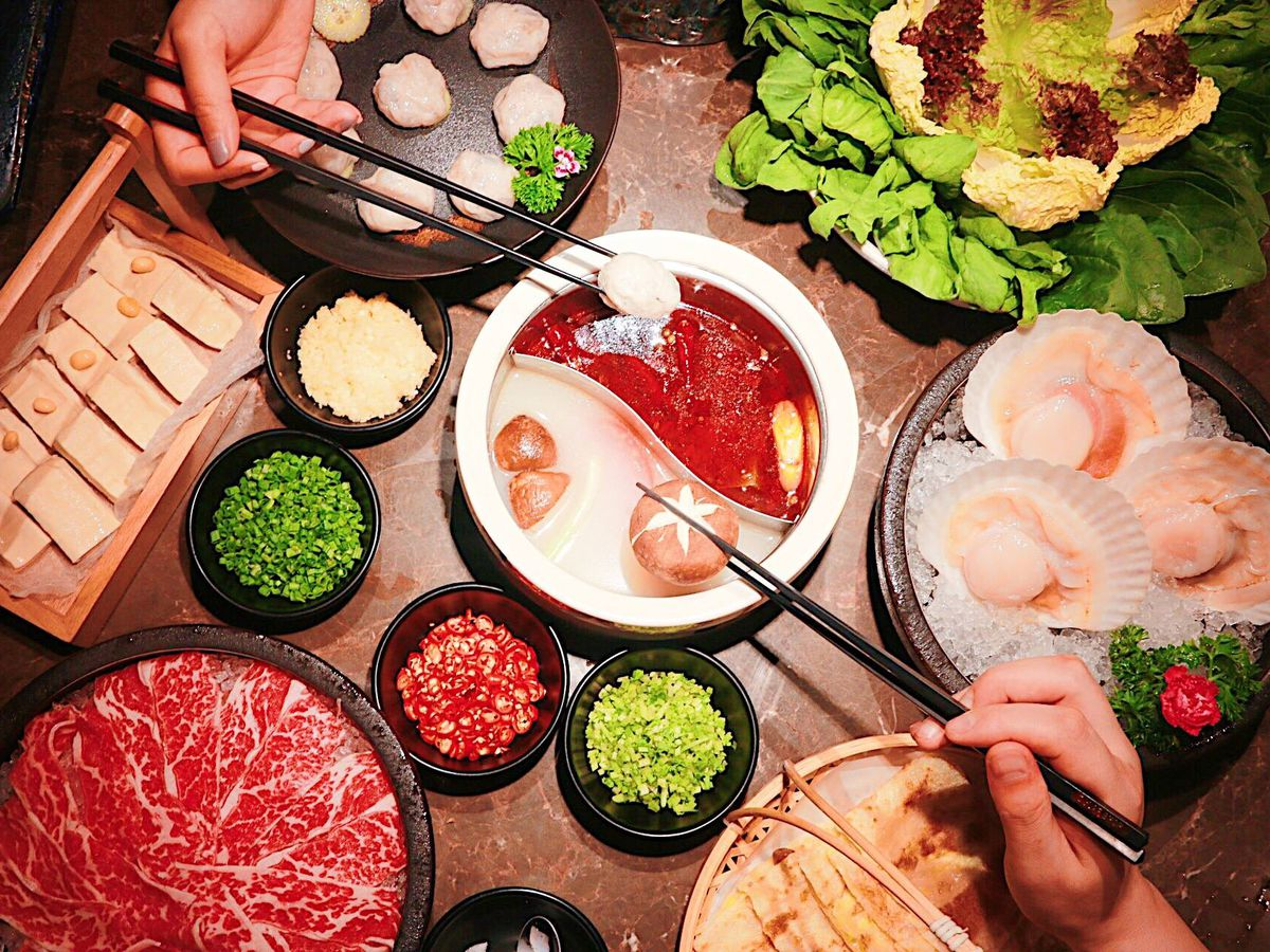 Hot pot with a variety of meats and sides at the Dolar Shop in Bellevue.