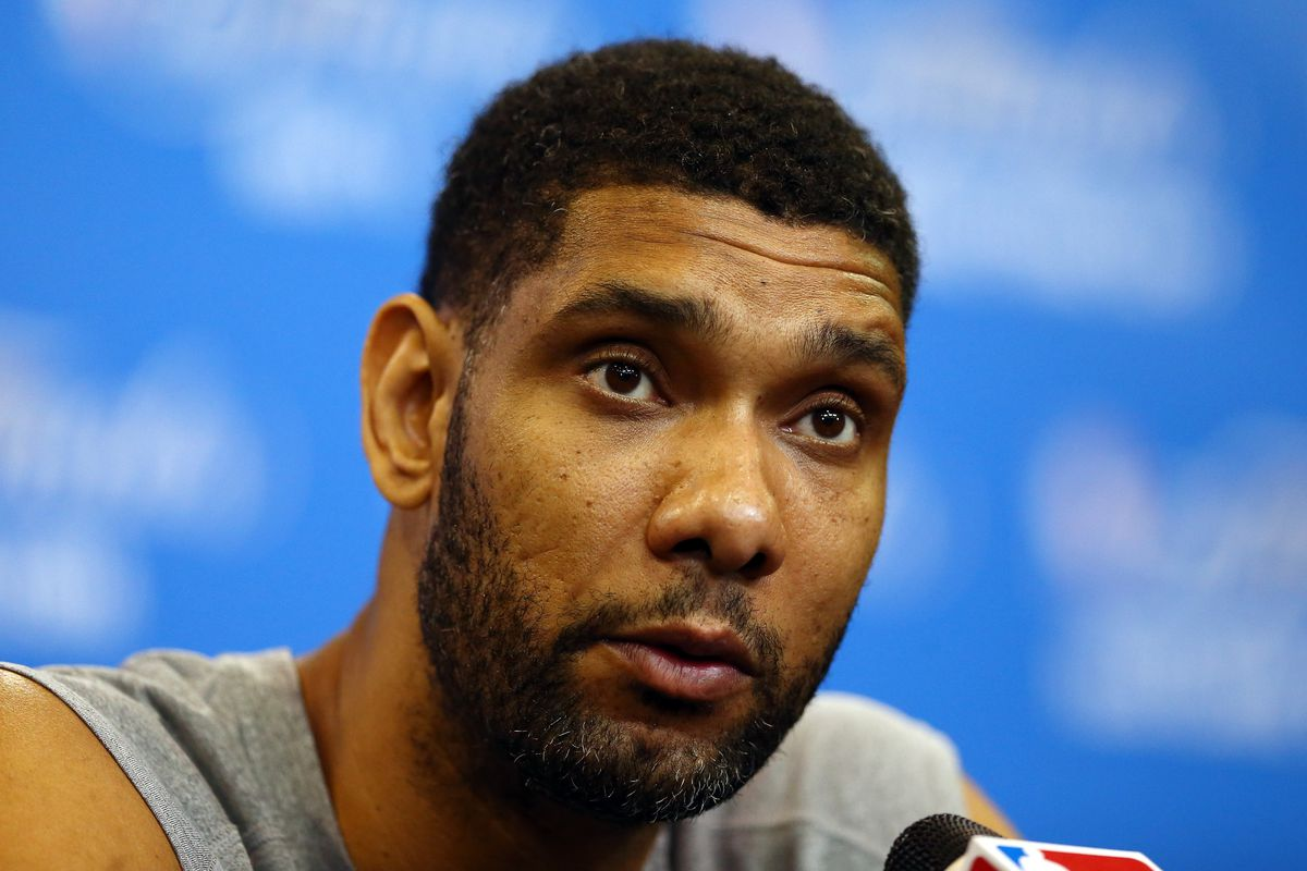Tim Duncan fields questions during a press conference after the announcement of his WoW accomplishment