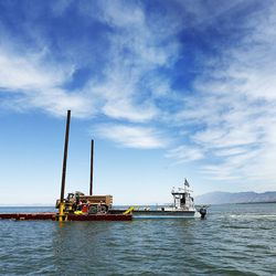 A barge carrying a dump truck floats on the water at Willard Bay on Thursday, June 9, 2016. The Utah Division of Wildlife Resources used the barge and dump trucks to place boulders in Willard Bay to enhance fish habitat.