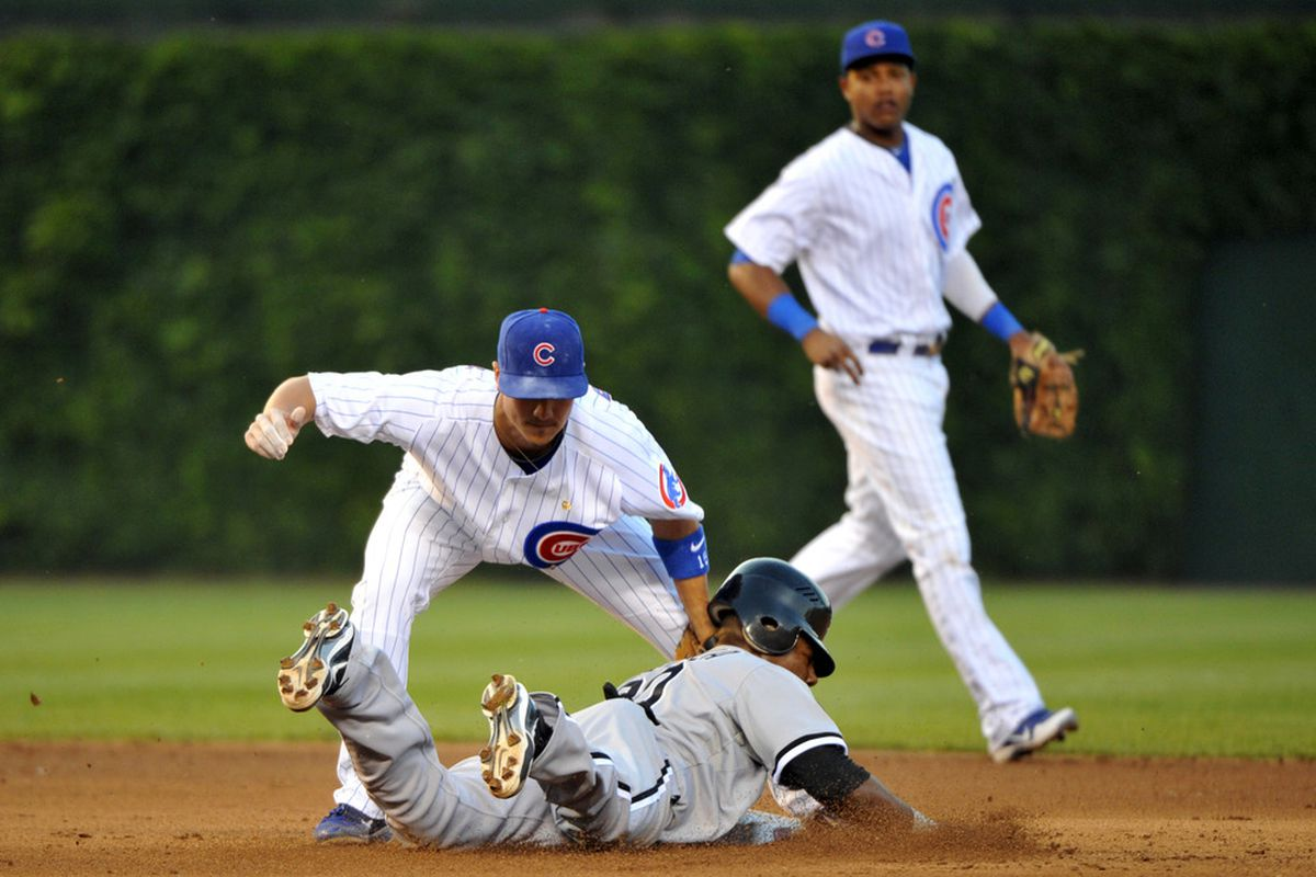 Chicago, IL, USA; Chicago Cubs second baseman Darwin Barney tags out Chicago White Sox center fielder Alejandro De Aza as he attempted to steal second base at Wrigley Field. Credit: Rob Grabowski-US PRESSWIRE