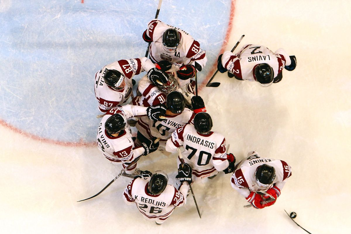 STOCKHOLM, SWEDEN - MAY 08: The team of Latvia celebrate after winning the IIHF World Championship group S match between Latvia and Italy at Ericsson Globe on May 8, 2012 in Stockholm, Sweden.  (Photo by Martin Rose/Bongarts/Getty Images)