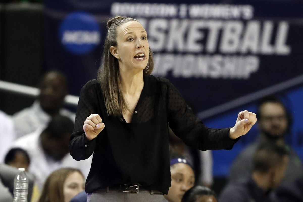California head coach Lindsay Gottlieb instructs her team in the first half of a first round women's college basketball game in the NCAA Tournament, in Waco, Texas. The Cavaliers have hired former California coach Lindsay Gottlieb as an assistant on John