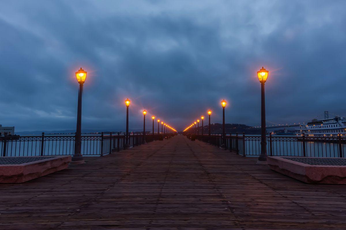 Dark clouds over a San Francisco pier.