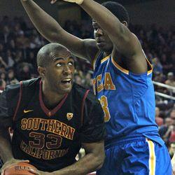 D.J. Haley eyes the basket with Tony Parker guarding him.