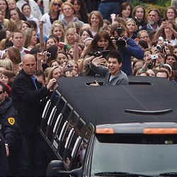 """Surrounded by fans, David Archuleta, of """"American Idol"""" fame, waves from a limo at The Gateway in Salt Lake City Friday."""
