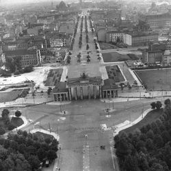 """Two weeks after the East German government sealed off the Soviet-occupied sector, Berlin's former chief crossing point between East and West, the Brandenburg Gate on """"Pariser Platz,"""" appears as no man's land, in this aerial view taken from the British sector of Berlin, on August 26, 1961."""