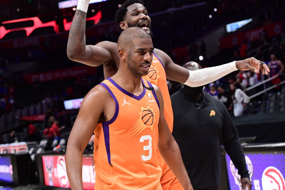 Deandre Ayton of the Phoenix Suns and Chris Paul of the Phoenix Suns walk off the court after the game against the LA Clippers during Game 4 of the Western Conference Finals of the 2021 NBA Playoffs on June 26, 2021 at STAPLES Center in Los Angeles, California.