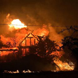 A home burns amidst the Yarnell Hill Fire in Yarnell, Ariz. on Sunday, June 30, 2013. The fire started Friday and picked up momentum as the area experienced high temperatures, low humidity and windy conditions. It has forced the evacuation of residents in the Peeples Valley area and in the town of Yarnell. (AP Photo/The Arizona Republic, Tom Story)