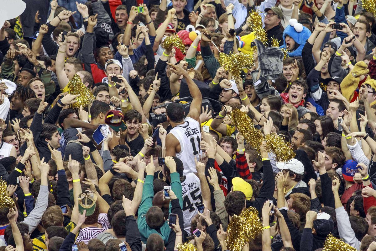 C.J. Harris is lifted up into a happy throng of Deacon fans after Wake Forest upset Miami, 80-65