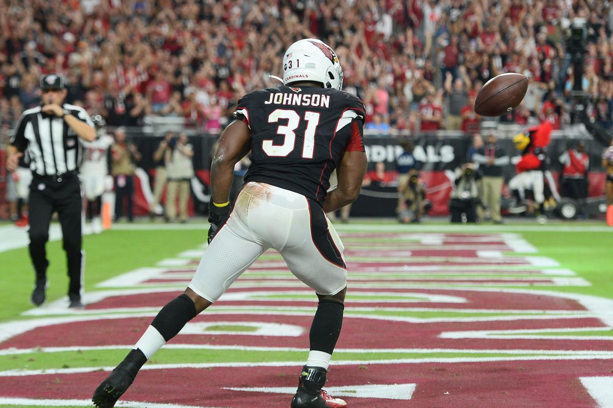 Arizona Cardinals running back David Johnson celebrates a touchdown catch against the Atlanta Falcons during the second half at State Farm Stadium.