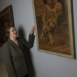 """Mary Immen Hall of Bennington, Vt., poses with the 1940 Norman Rockwell illustration """"A Scout is Helpful"""" for which she modeled at the Bennington Museum on Friday, Sept. 28, 2012, in Bennington, Vt."""