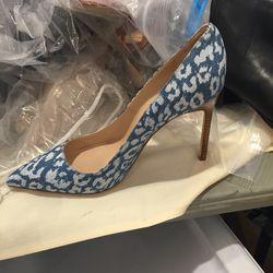 Plain printed fabric heel, size 37, $125